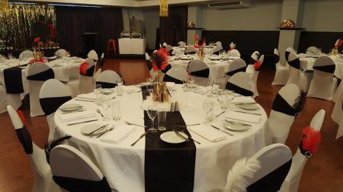 Table and chairs setup for Gatsby Party at Darwin